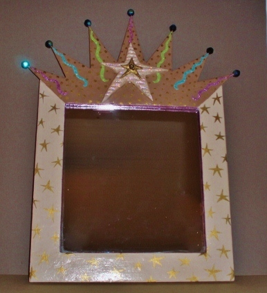 framed crown mirror by Lynda Makara