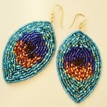 Beaded peacock earrings by Lynda Makara