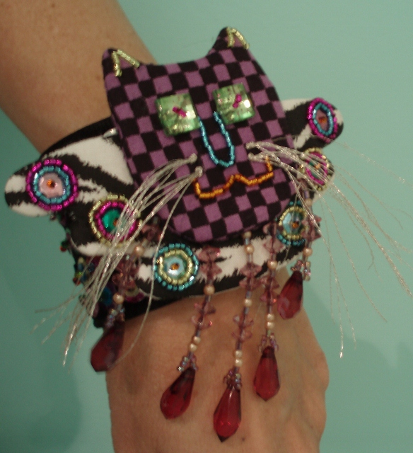 angel kitty pinned to cuff bracelet