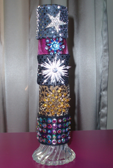 A tower of beautiful handmade fabric cuff bracelets