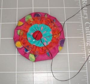 stitch ladybug to yo yo flower