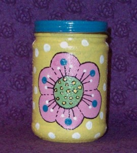 yellow jar with pink flower