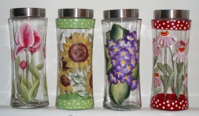 glass canisters with flowers