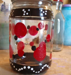 black and red dots on glass jar