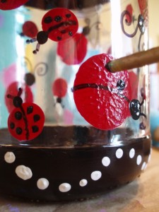 black dots painted on ladybug jar