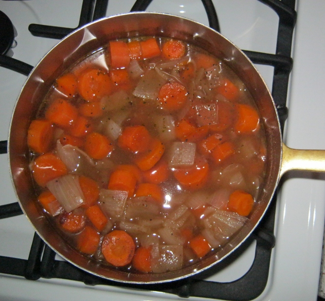 Cooked vegetables for carrot soup