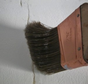 brush dust out of drywall cracks