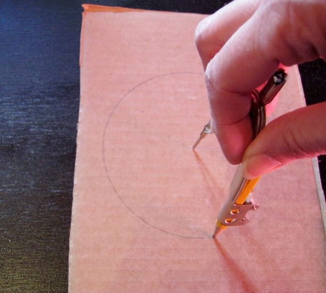 draw circle on cardboard for starburst mirror