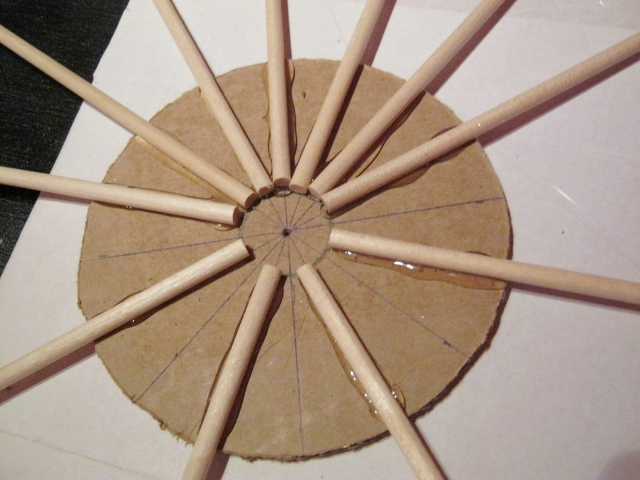glue dowels to cardboard for starburst mirror
