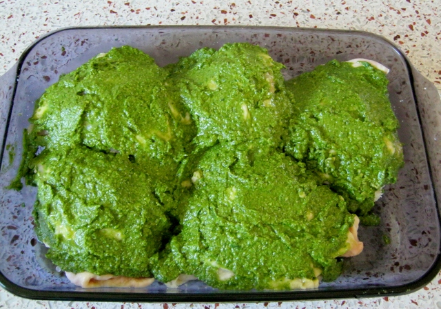 chicken coated with pesto before baking