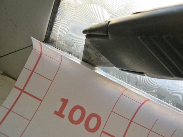 cutting off excess window film