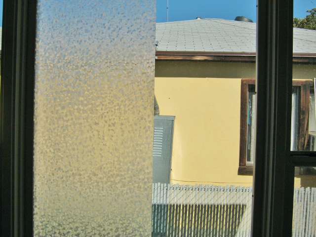 window half covered with privacy film
