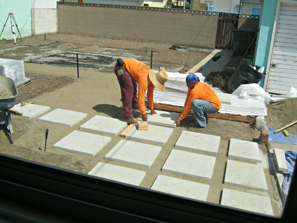 Install pavers on top of sand