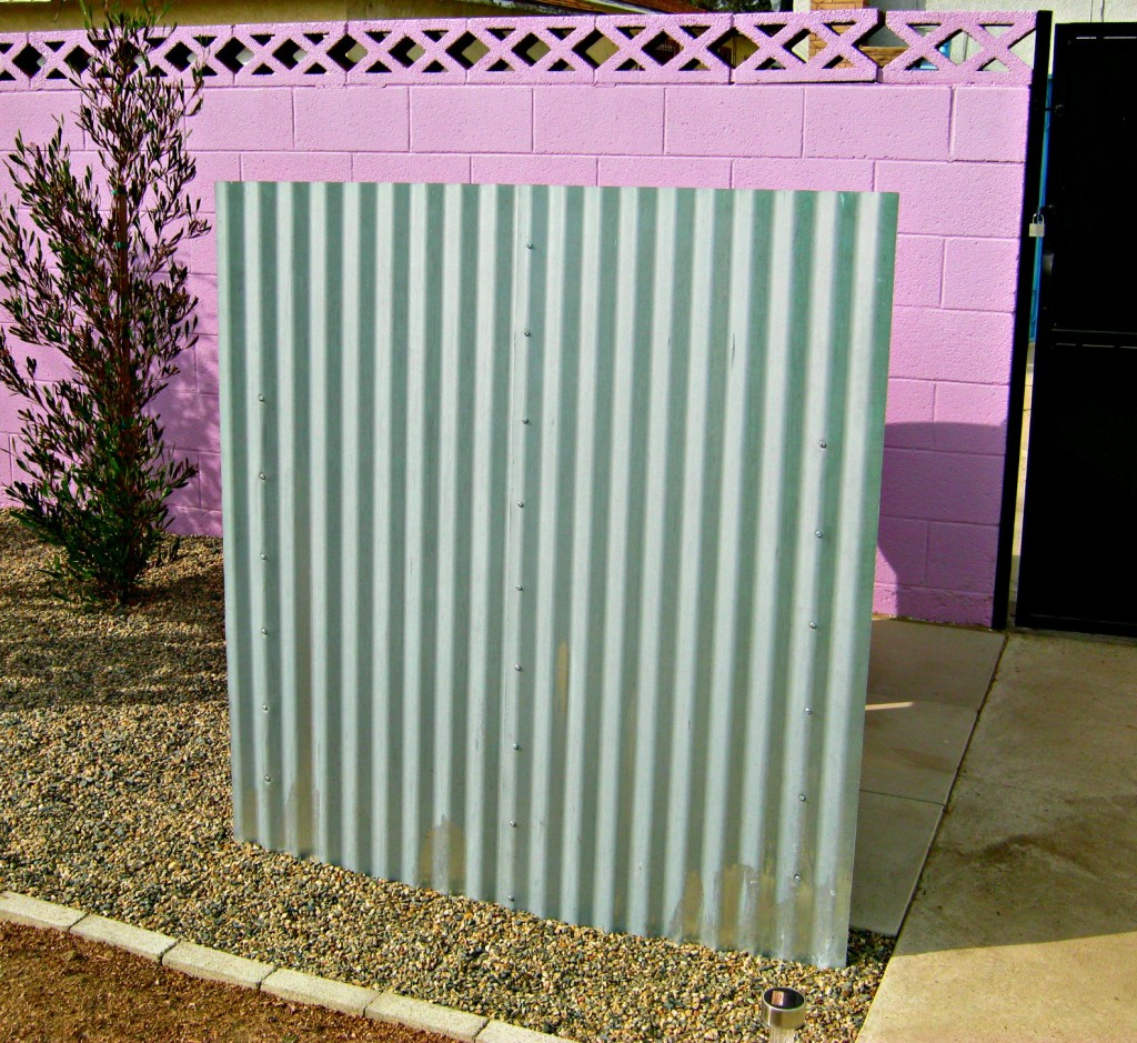 DIY garbage can fence made from roofing panels