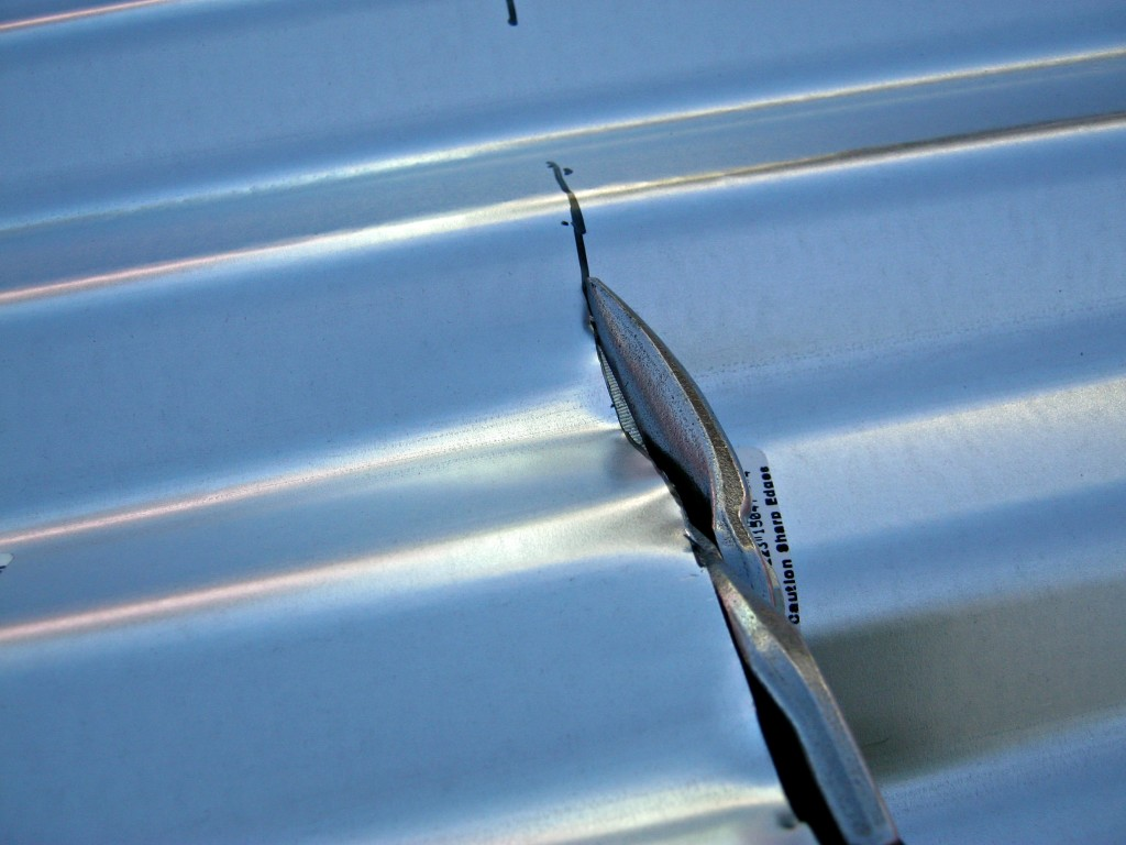 Cut roofing panels with tin snips
