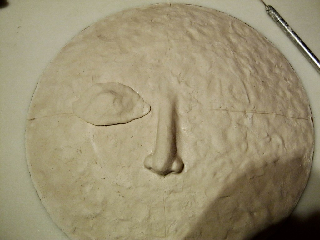 Nose added to moon sculpture, working on right eye