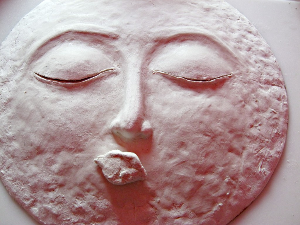 moon sculpture with eyebrows, piece added for mouth