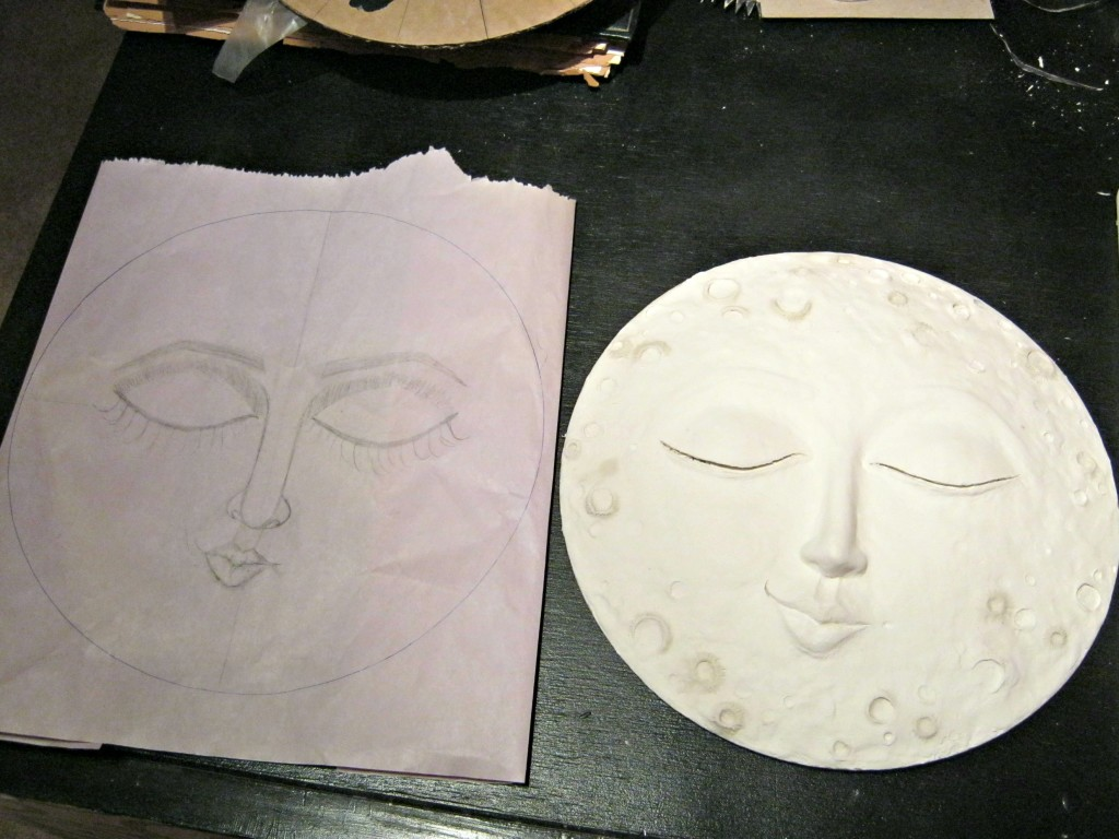 Comparing the finished moon sculpture to the drawing