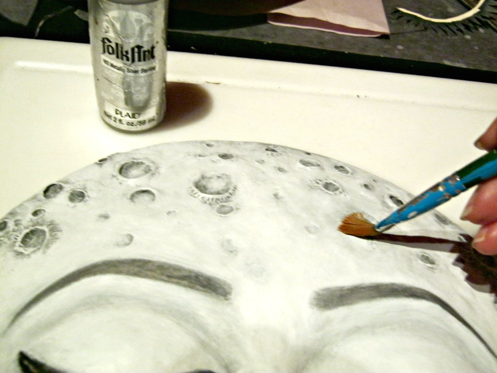 Highlighting moon sculpture with metallic silver paint