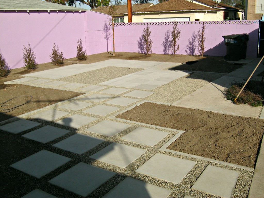 Outlining flowerbeds, spreading weed fabric and gravel