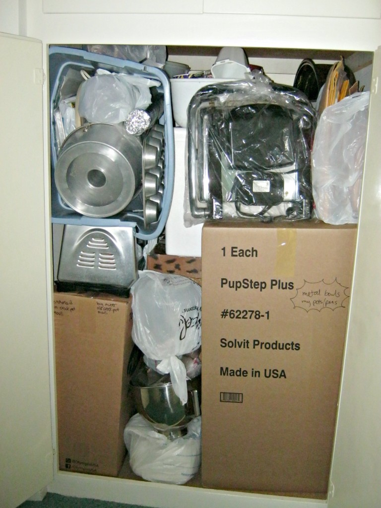 Hall closet stuffed full of kitchen items