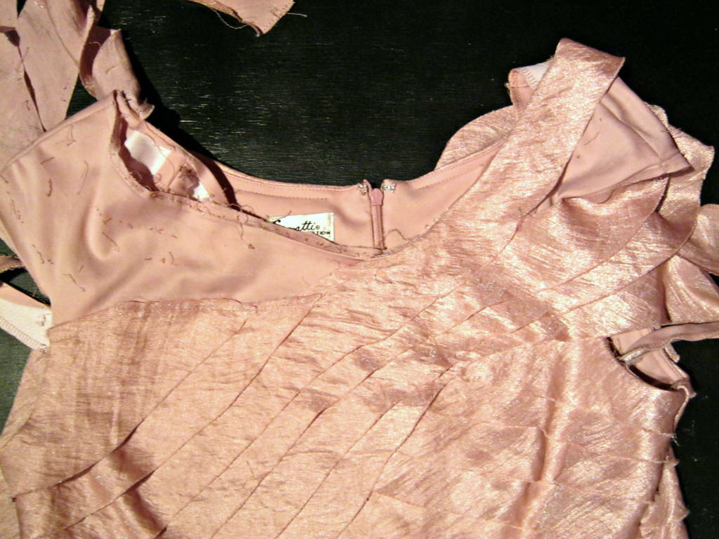 Strips being detached from dress