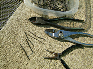 Tie wire, wire cutters and pliers for fastening gopher fence