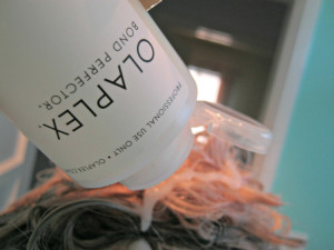 Putting Olaplex #2 on my hair (looks like conditioner)