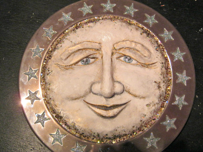 Sun sculpture with paint and glitter